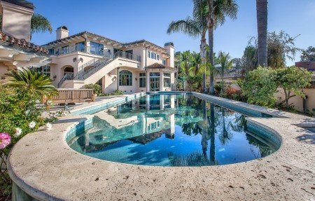 Contact Palisades Painting Co., picture of a local home and pool.