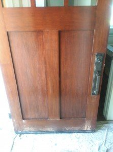 """A """"before"""" picture of a customer's front door with a finish badly eaten up by the sun. Palisades Painting Company. A Tail and One Door"""
