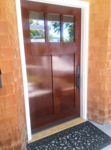 """The """"after"""" picture of a customer's front door finished by Palisades Painting Company."""