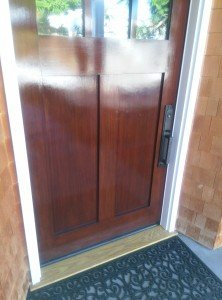 """The """"after"""" picture of a customer's front door finished by Palisades Painting Company. A Tail and One Door"""